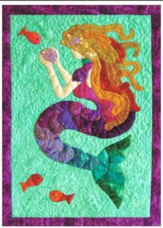 There have always been tales of Mermaids under the sea. This beautiful design brings the story to life. This wall hanging was stitched using the needle-turn appliqué (full instructions included) howev