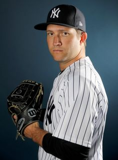 Adam Warren #43 of the New York Yankees poses for a portrait during the New York Yankees photo day on February 21, 2018 at George M. Steinbrenner Field in Tampa, Florida. - 76 of 200