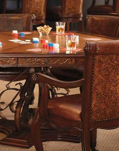 Give your husband the game room he's always dreamed of with the Saratoga Game Table and Four Chairs that features distinctive style and handsome finish.