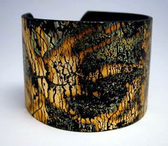 This is gorgeous!! Black Cuff Bracelet Polymer Clay Gold Leaf Gold by PolymerPlayin,
