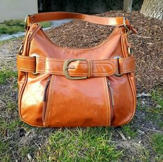 Shop Women's unknown Brown size OS Hobos at a discounted price at Poshmark. Description: Camel Brown Vegan Leather Hobo Bag. I don't know the name brand of this bag but it's pretty nice looking. ???? This purse has alot of personality and flare due to the oversized buckle embelished by a variety of of hardware features to include multiple zippers studs and brass rings. The front two zippers hide two lil pockets to hold small iems.  I think it would look great with a white linen dr...