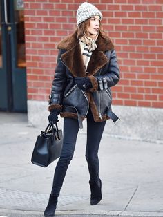 Alexa Chung in a black and brown shearling Acne Studios jacket in New York City.