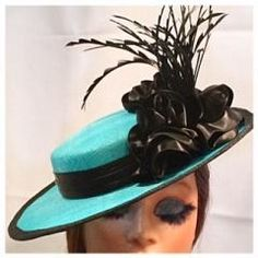 Kentucky Derby, Mother's Day, Easter, Garden Parties, Weddings- there are so many places that will be packed with boring straw hats. You can stand out (and perhaps win a prize) with this sassy and luxurious percher hat. Where to buy Kentucky Derby hats? A milliner, of course. This hat is entirely handmade and hand blocked from aqua/turquoise sinamay, trimmed with luxe rayon satin ribbon fashioned into an abundance of rosettes. Black hand cut feathers give the design movement and interest…