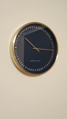 MADE.com brushed brass Midnight Hour wall clock in navy