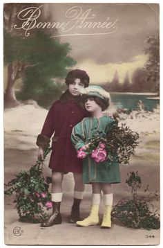 This is an Edwardian Era hand tinted photo postcard of a 2 beautiful children in their winter coats. The text on the front of the card, Bonne: