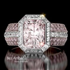 A magnificent fancy colored diamond ring Frame of Fire™- features fancy pink Radiant cut center with Blaze® diamond halo and eternity channel set shank.  http://www.bezambar.com/shop/frame-fire-engagement-ring-fancy-pink-radiant-cut-diamond/