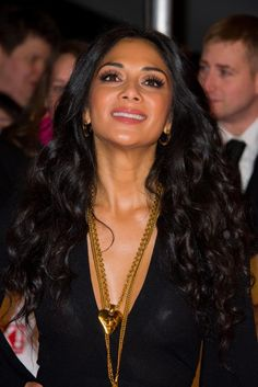 "Nicole Scherzinger springkled in gold, wearing a Vintage Chanel ""CC Heart"" golden pendant with chain, and the Chanel Vintage ""CC Burst"" necklace at the 2013 National Television Awards held at the O2 Arena in London. January 2013"