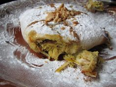 Moroccan food: bastilla chicken, dough filled with chicken and almonds and dusted with icing sugar .. yes, chicken dusted with icing sugar!! And that seems to be very tasty!! :)