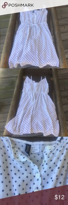 Cute Polka-dotted White Divided by H&M Dress A gently used polka-dotted Divided by H&M dress. Casual wear. Size 4. The polka dots are either very dark navy blue or black, it is hard to tell. Divided Dresses