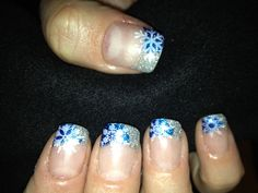 Blue festive snowflake nails