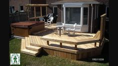 This deck plan is for a very large two level deck with a spa and bench .