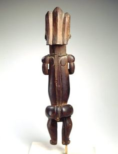 Master of Ntem. Reliquary Guardian Figure (Eyema-o-Byeri), mid-18th to mid-19th century. Wood, iron, 23 x 5 7/8 x 5 in. (58.4 x 14.9 x 12.7 cm). Brooklyn Museum, Frank L. Babbott Fund, 51.3. Creative Commons-BY (Photo: Brooklyn Museum, 51.3_back_SL4.jpg)