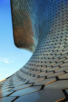 """Museo Soumaya by FR-EE    """"clad the building in a unique translucent concrete that filters natural sunlight, and allows the interior spaces to feel open and light without sacrificing the material's structural integrity."""""""