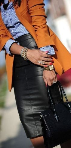 Chic black leather pencil skirt with blue blouse and orange blazer.