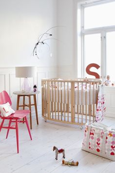 Clean white feels modern with a few perfectly placed pops of pink  #baby #nursery #girl #pink #white