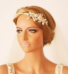 This girl looks like a manacin (how do you spell that?) ...but I love the little head accent but would combine it with a lace veil still!