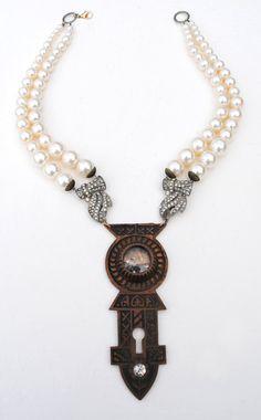 Victorian Cast Brass Escutcheon Keyhole Jewel Shadowbox Art Deco Rhinestone Faux Pearl Necklace.  via Etsy.