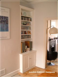 Fitted alcove cupboard with library style bookcase.