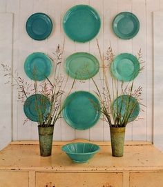 Look no further than your own kitchen for an inexpensive and easy wall-art idea. Hang plates of varying shapes and sizes in a single bold hue against a pale wall for a vivid pop of beachy color