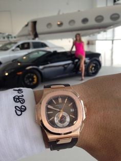 Custom made and embroidered shirt from Tom James Executive Collection paired with Patek Philippe Nautilus 5980R. A good combination?  Girlfriend in background leaning against black Lamborghini Gallardo LP-550, ready for a ride.  #custommadesuits   #patekphilippe   #5980r   #lamborghinigallardo   #mensfashion   #luxury