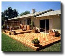Most grade-level decks are actually a step above grade (ground level). This allows the deck to drain easily and resist rot. If you don't have a concrete patio to deck over, a simple foundation of posts or concrete pads can provide support. Grade-level decks are the easiest decks to build.