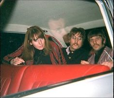 February 19, 1967 A fan photo of Cynthia Lennon, who is sitting on her husbands lap, John Lennon and Ringo Starr in the backseat of a car after attending a Chuck Berry concert at Brian Epstein's Saville Theatre. Brian Epstein's reflection can be seen on the window