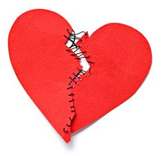 Broken heart tied up with thread