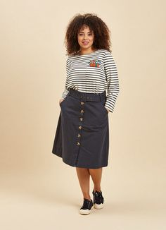 The Gladys Belted Button Skirt is a navy utility-style skirt with a tortoiseshell button-through front, pockets and buckle belt. Joanie Clothing, Retro Fashion, Vintage Fashion, Button Skirt, Get The Look, Skirt Fashion, Vintage Looks, A Line Skirts, Pinup