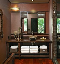 Powder Room Design - really like the vanity but how cool is the window behind the mirror which looks like it may slide.