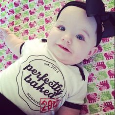 """Oh hello Miss Bayla Rose. She looks fab-u-lous wearing our """"Perfectly Baked 2014"""" onesie! 2015 available in shop now! #kidsfashion #kidsclothing #onesie #babies"""