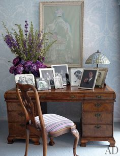 At a desk that belonged to Taylor's father is a chair upholstered in a Scalamandré velvet; the Tiffany-style lamp was made by Taylor's son Christopher Wilding. The painting by Marcel Vertès commemorates the birth of Liza, Taylor and Mike Todd's daughter.