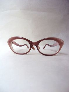 Lovely vintage frames on etsy  http://www.etsy.com/listing/74865809/1960s-pearlized-mink-lucite-spectacles