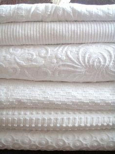 White coverlets:  I'd love to add these to my linen closet.  I'm a fanatic for using only cotton on the bed (there's nothing more comfortable for sleeping) AND for adding that one textured piece to give the bed that luxurious feel.