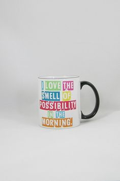 Love the smell of possibility coffee mug! Design is heat pressed into the mug so they are won't ever fade. They are also scratch proof and dishwasher safe.  Measures 11 oz.  Possibility Coffee Mug by Fly Paper Products. Home & Gifts - Home Decor - Dining - Dinnerware Rhode Island