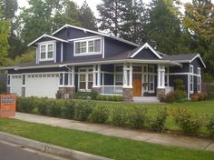 Dark Blue Exterior House Color With White Trim And Wood Tone Door