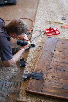 DIY: Sliding Barn Door Hardware Installation - awesome tutorial, with lots of pictures, that show step-by-step how to install the hardware on the door & wall. Make a barn door into a kitchen table Sliding Barn Door Hardware, Sliding Doors, Door Latches, Diy Barn Door, Install Barn Door, Entry Doors, Front Doors, Building A Barn Door, Window Hardware