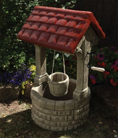 Stone Wishing Well Garden Feature. A traditional design which would add character to any garden.