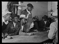 Negroes spending their cotton money in gambling in juke joint. Saturday night, outside Clarksdale, Mississippi Delta