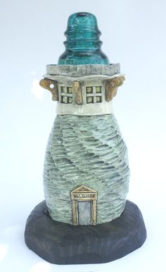 Insulator Lighthouses by Robyn Brakel