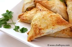 Spanakopita -- A savoury Greek pastry Delish-Dish, minus the eggs in this recipe. Spanakopita Triangles Recipe, Spanakopita Recipe, Greek Spinach Pie, Greek Pastries, Easy Appetizer Recipes, Appetisers, Greek Recipes, No Cook Meals, Vegetarian Recipes