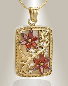 Gold Plated In Bloom cremation jewelry and flower memorial pendants in honor of loved ones.  Choose many styles flower memorial keepsakes to create remembrance.