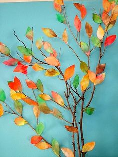 Coffee filter autumn leaves glued to a branch-Repinned by Totetude.com