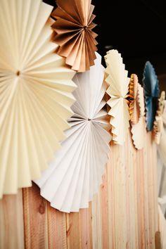 DIY paper wheels, photo by Katie Ruther http://ruffledblog.com/handcrafted-fall-wedding #diy #paperwheels #weddingdecor