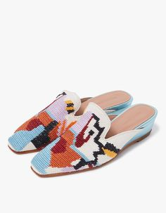 Slip-on mule from Rachel Comey in Needlepoint. Square toe. Leather lining. Tonal stitching. Padded footbed with embossed logo. Metallic leather wrapped wedge. • Embroidered weave upper • Leather sole • Women's sizes listed