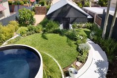 A plunge pool has been created from a concrete water tank craned onto the site and tiled in mosaics.