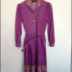 PRICE DROP Retro Purple and Red Paisley Dress Fun purple paisley shirt dress with matching belt. Blouse style top, pleated skirt  with elastic at the waist. Please ask all questions before purchasing. Vintage Dresses