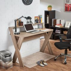 This home or office desk has rich options that will look great in a modern office space. It has a primary desk that's good for a laptop or desktop computer and a secondary shelf for extra items like ornaments, plants or photos.
