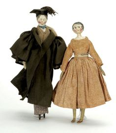 "England, ca. 1830, including peg jointed man dressed in scholarly attire, painted molded features, and a wooden shoulder head woman with painted molded features on a kid body with wooden arms and legs, original calico clothing  Size: 9.5"" t."