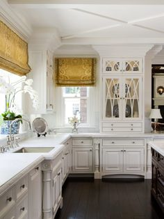 luv the stark white kitchen and the window treatments . . . statement!