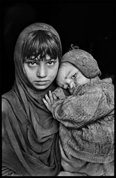 Steve McCurry Afghanistan; 1980. A young girl holds her sibling.